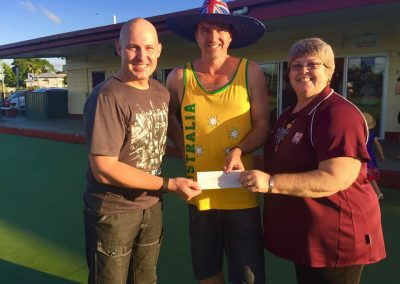 Curtis presents cheque to Innisfail PCYC.jpg